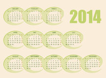 2014 Calendar. Calendar for 2014 year with light backdrop of green ovals Stock Photography