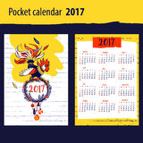 Calendar for year 2017 with silhouette and christmas. Decoration on color background. Design Illustration calendar with symbol year red rooster 2017 vector illustration