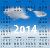Calendar for 2014 year in Spanish with clouds in the blue sky. Mondays first. Vector illustration Royalty Free Stock Photo