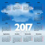 Calendar for 2017 year in Spanish with clouds. In the blue sky. Mondays first. Vector illustration Stock Photo