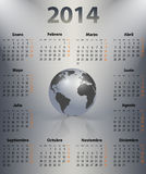 Calendar for 2014 year in Spanish with the world globe in a spot. Mondays first. Vector illustration Royalty Free Stock Photo