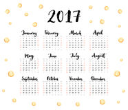 Calendar 2017 year. Week starts Sunday. One sheet with handwritten months and golden spots. Modern vector design. Stock Photo
