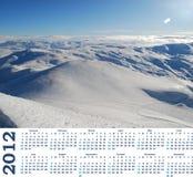 Calendario 2012 con la vista de las montañas de la nieve Imagen de archivo libre de regalías