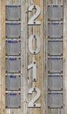 calendario 2012 sobre tablones de madera viejos Imágenes de archivo libres de regalías