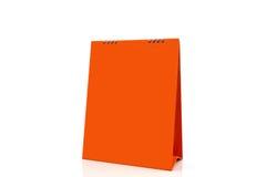 Calendario anaranjado del espiral del escritorio del papel en blanco Imagen de archivo