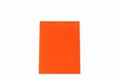 Calendario anaranjado del espiral del escritorio del papel en blanco Imágenes de archivo libres de regalías