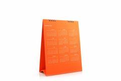 Calendario anaranjado 2016 del espiral del escritorio del papel en blanco Imágenes de archivo libres de regalías