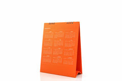 Calendario arancio 2016 di spirale dello scrittorio della carta in bianco Fotografia Stock Libera da Diritti