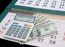 Calendario, calculadora y dólares Imágenes de archivo libres de regalías