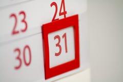 Calendario con 31 en foco Imagen de archivo libre de regalías