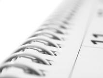 Calendario con el atascamiento espiral Foto de archivo libre de regalías