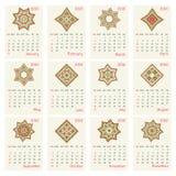 Calendario 2016 con el modelo redondo étnico del ornamento en colores rojos y verdes Foto de archivo
