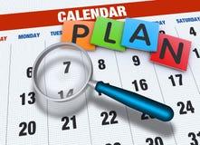 Calendario con la lupa Imágenes de archivo libres de regalías