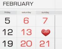 Calendario con los corazones el 14 de febrero Fotos de archivo