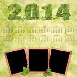 Calendario 2014 con los marcos retros de una foto Fotografía de archivo libre de regalías