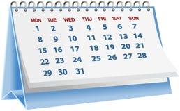 Calendario da scrivania blu isolato su bianco Fotografia Stock