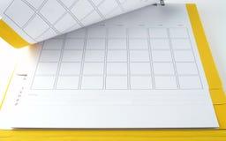 Calendario da scrivania giallo in bianco con le linee per le note su fondo bianco Fotografia Stock