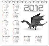 calendario de 2012 años con el dragón negro del origami. Imagen de archivo libre de regalías