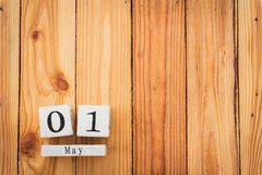 Calendario de bloque de madera para el día de trabajo, el 1 de mayo Imagen de archivo libre de regalías