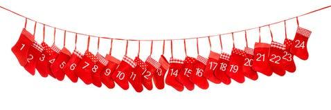 Calendario del advenimiento Calcetines rojos de la Navidad Decoración de los días de fiesta Fotografía de archivo libre de regalías