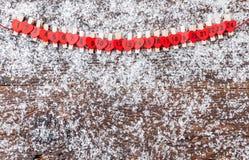 Calendario del advenimiento de la Navidad con nieve Fotografía de archivo