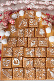 Calendario del advenimiento, galletas de la Navidad Fotos de archivo