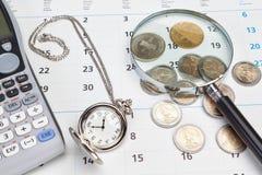 Calendario del asunto, reloj de bolsillo. Fotografía de archivo