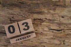 Calendario del cubo para enero en fondo de madera Imagen de archivo