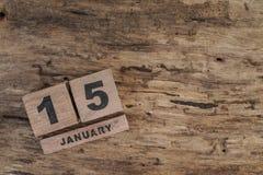 Calendario del cubo para enero en fondo de madera Foto de archivo libre de regalías