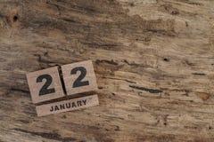 Calendario del cubo para enero en fondo de madera Foto de archivo