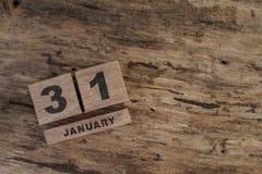 Calendario del cubo para enero en fondo de madera Fotografía de archivo libre de regalías