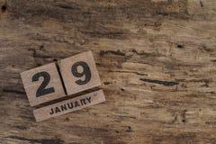 Calendario del cubo para enero en fondo de madera Fotos de archivo