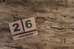 Calendario del cubo para enero en fondo de madera Imagen de archivo libre de regalías