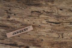 Calendario del cubo para enero en fondo de madera Fotografía de archivo