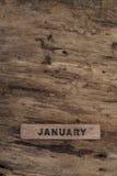 Calendario del cubo para enero en fondo de madera Imágenes de archivo libres de regalías