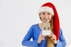 Calendario della tenuta della donna di Natale Immagini Stock