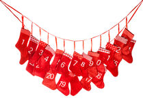 Calendario di avvenimento Calza rossa di natale isolata su bianco Immagini Stock
