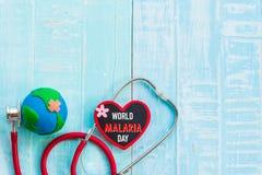 Calendario di blocco di legno per il giorno di malaria del mondo, il 25 aprile Immagine Stock Libera da Diritti
