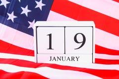 Calendario di legno con la data del 19 gennaio sulla bandiera americana Compleanno Robert Edward Lee Fotografia Stock