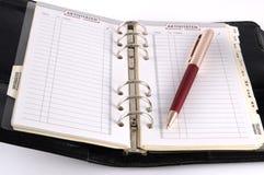 Calendario di scrittorio con la penna Fotografie Stock