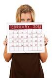 Calendario 2015: El mirar a escondidas sobre el calendario de febrero Foto de archivo libre de regalías