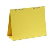 Calendario giallo in bianco Fotografia Stock