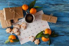 Calendario o giorno di Natale con il testo della nota della festa, concetto per Immagini Stock