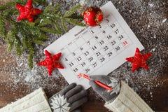 Calendario o giorno di Natale con il testo della nota della festa, concetto per Immagini Stock Libere da Diritti