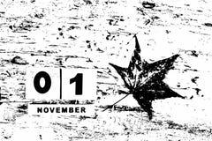 Calendario per il 1° novembre su fondo strutturato in bianco e nero w Immagini Stock