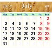 Calendario per il luglio 2017 con il campo di grano Immagini Stock