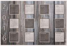 Calendario per 2016 su fondo di legno Immagine Stock