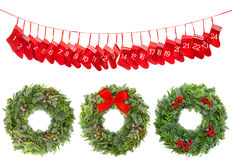 Calendario rosso di arrivo dell'arco del nastro della corona della decorazione di Natale Fotografia Stock