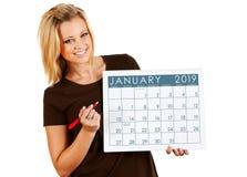 Calendario 2019: Scrivendo su un calendario di gennaio fotografia stock
