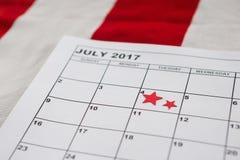 Calendario segnato con la decorazione di forma della stella Immagine Stock